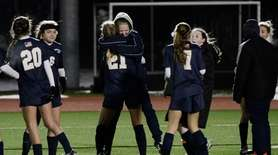 The Massapequa Chiefs celebrate after defeating Clarence, 1-0,