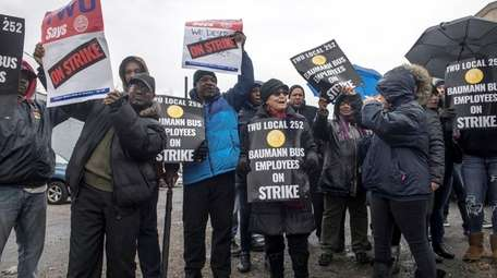 Members of TWU Local 252 strike outside Baumann