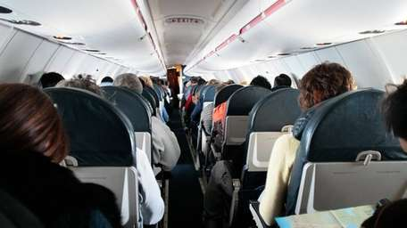 Inside of a plane cabin while in flight.