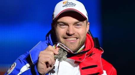 France's David Poisson holds his bronze medal during
