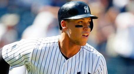 Aaron Judge watches the flight of his sixth-inning