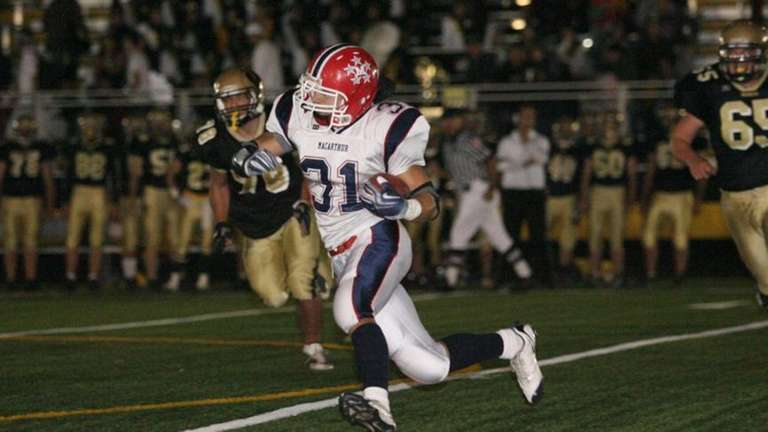 MacArthur's Tom Joyce gains some yards during the
