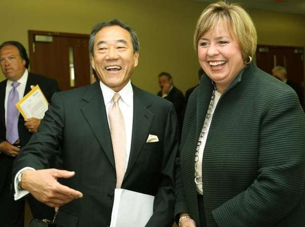 Lighthouse developer Charles Wang, left, talks with Hempstead