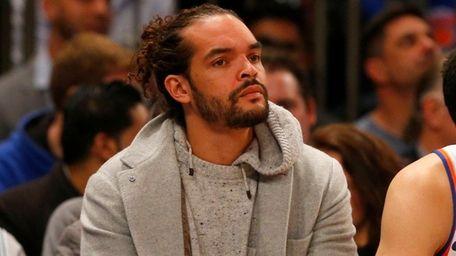 Joakim Noah of the Knicks looks on from