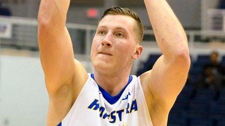 Hofstraforward Rokas Gustys shoots a foul shot against