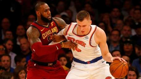 Kristaps Porzingis of the Knicks controls the ball