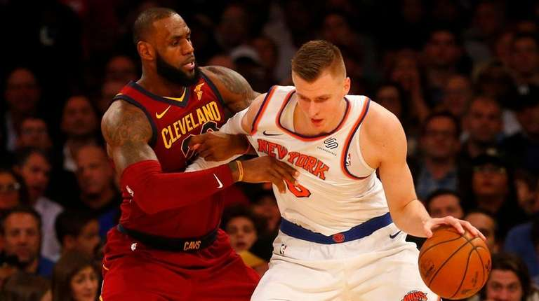 Kristaps Porzingis  of the Knicks controls the ball