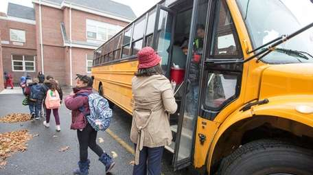 Students are dropped off at Archer Street Elementary
