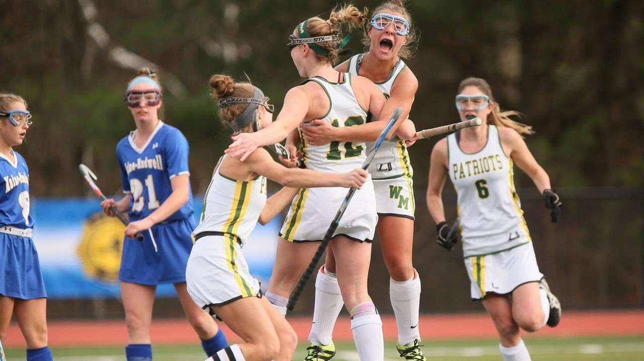 Ward Melville celebrates after scoring the game-winning goal in