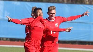 Center Moriches' Eric Amaya, left, celebrates with Ben