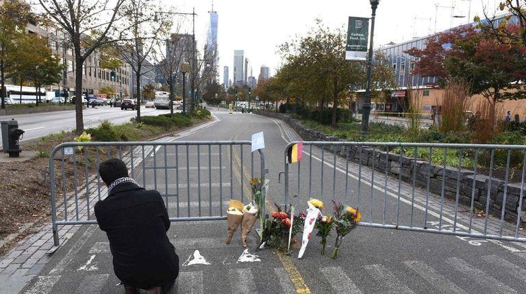People stop at a memorial Nov.1, 2017 near