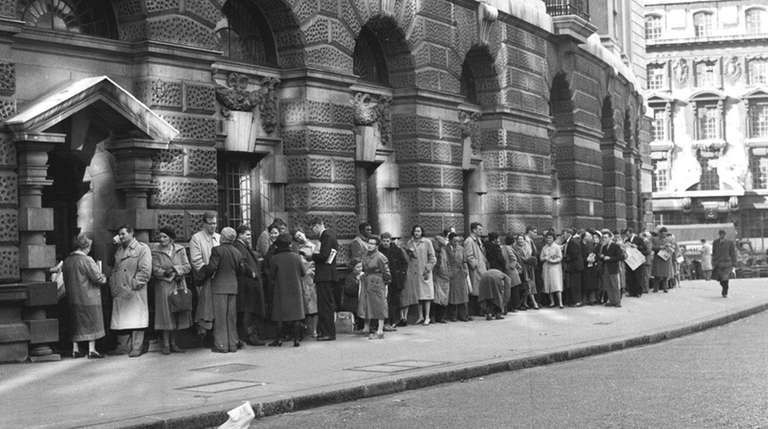 A queue forms outside The Old Bailey Central