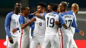 U.S. player Weston McKennie, center, celebrates with teammates during