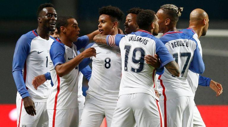 U.S. playerWeston McKennie, center, celebrates with teammates during