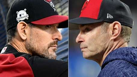 Diamondbacks manager Torey Lovullo, left, and Twins manager