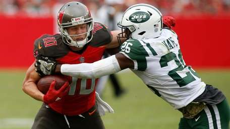 Buccaneers wide receiver Adam Humphries is tackled by