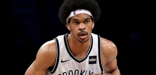 Nets center Jarrett Allenlooks down the court during