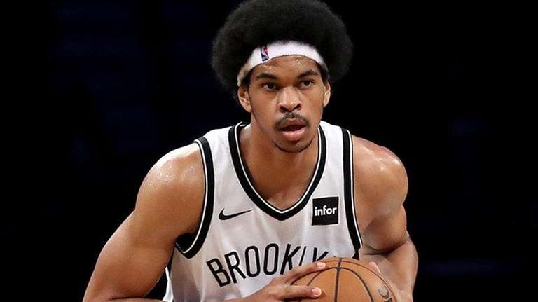 Nets center Jarrett Allen looks down the court during