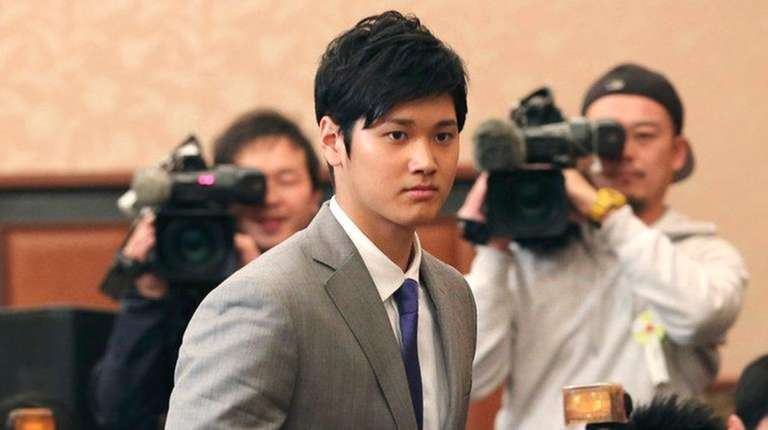 Japanese pitcher-outfielder Shohei Ohtani arrives for a press