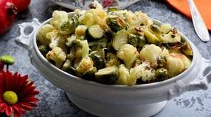 Cauliflower and Brussels sprouts are roasted and dressed
