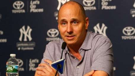 General manager Brian Cashman speaks to the media