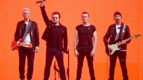 U2 -- Adam Clayton, left, Bono, Larry Mullen