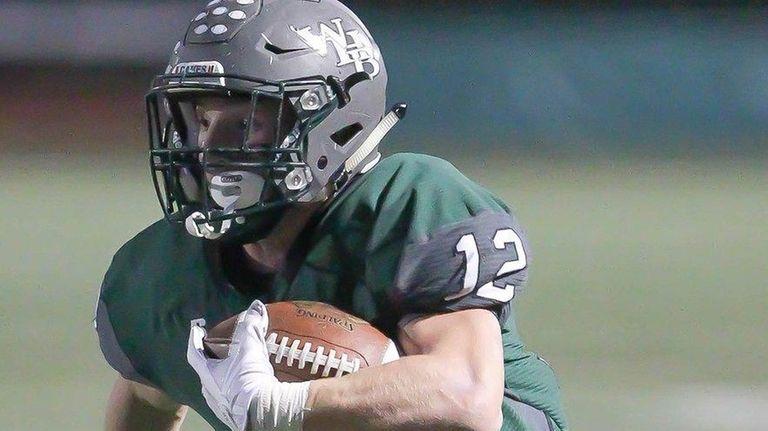 Westhampton's Dylan Laube runs the ball against Sayville