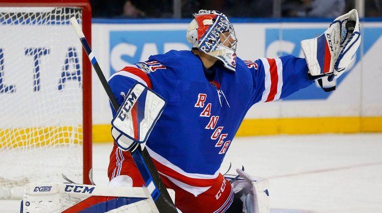 Ondrej Pavelecof the Rangers makes a save against
