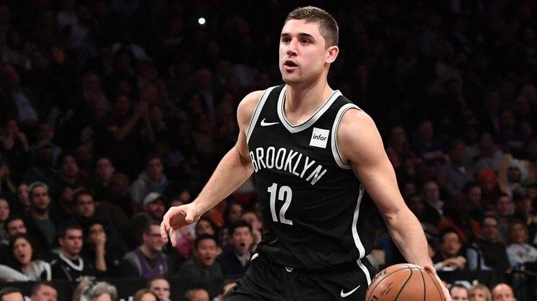 Nets guard Joe Harris drives to the basket