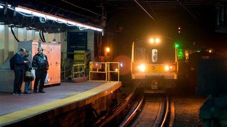 An LIRR train rolls along Track 18, one