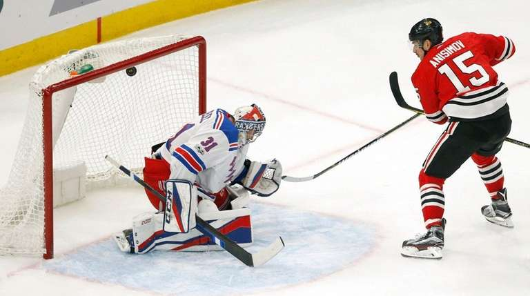 The Blackhawks' Artem Anisimov scores his hat trick