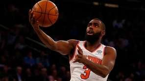 Tim Hardaway Jr. of the Knicks goes to the