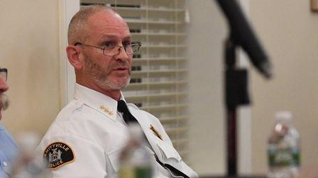 Amityville Police Chief Glenn Slack speaks during a