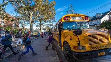 Students board Baumann buses Nov. 10, 2017, in