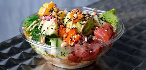 A build-your-own poke bowl served over quinoa at