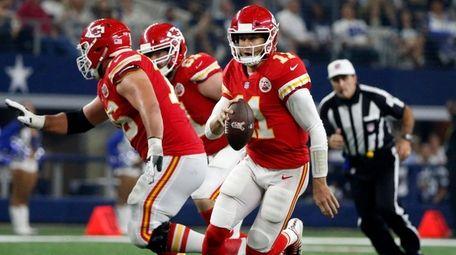 Chiefs quarterback Alex Smith runs the ball during