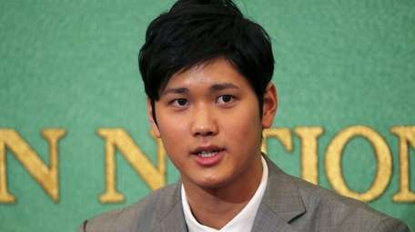 Pitcher-outfielder Shohei Ohtani speaks during a press conference