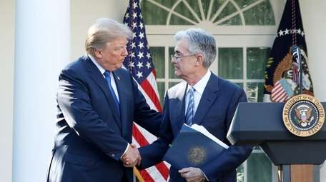 President Donald Trump shakes hands with his nominee