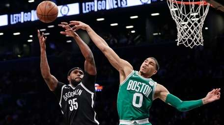 The Celtics' Jayson Tatum blocks a shot by