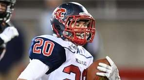 Miller Place's Anthony Filippetti runs the ball for