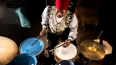 Napoleon Revels-Bey plays on his drumset inside his