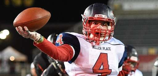 Miller Place's Tyler Ammirato scores a touchdown against