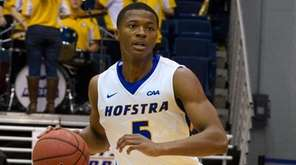 Hofstra guard Eli Pemberton heads upcourt on Kennesaw State guard