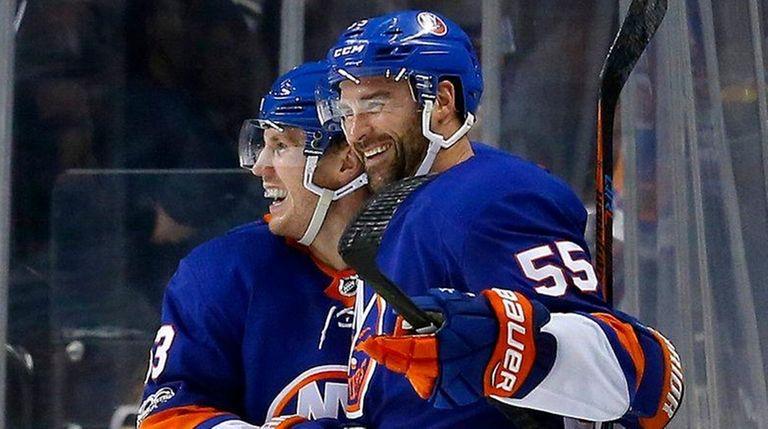 The Islanders' Johnny Boychuk celebrates a goal against