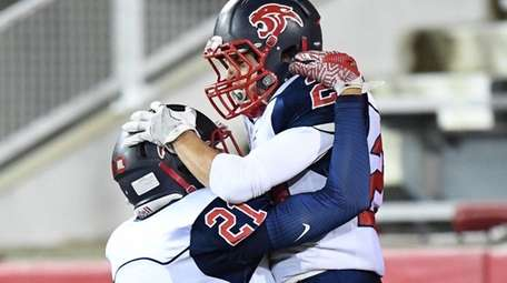 Miller Place's Coleton Reitan, left, congratulates Anthony Filippetti