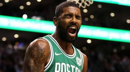Celtics guard Kyrie Irving celebrates during a game