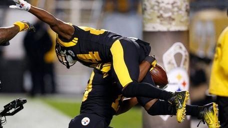 Steelers wide receiver Antonio Brownis hoisted by JuJu
