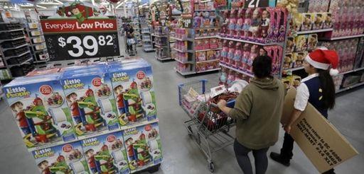 A shopper and a Walmart associate walk near