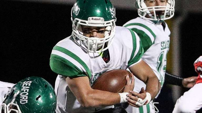 Seaford's Tyler Volpibreaks through the line during the