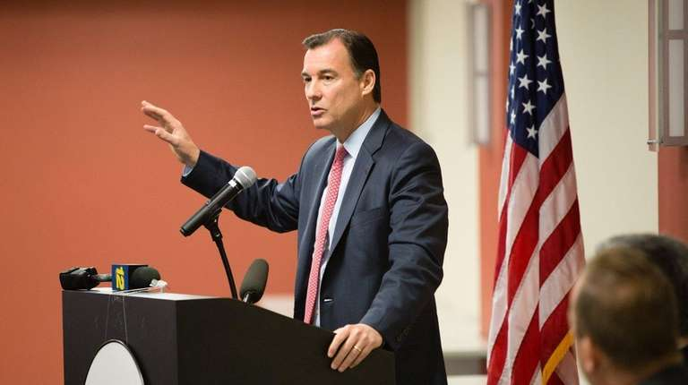 Rep. Thomas Suozzi speaks during an executive breakfast